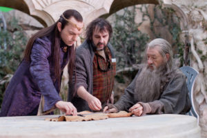 "(L-r) HUGO WEAVING, director PETER JACKSON and IAN McKELLEN on the set of the fantasy adventure ""THE HOBBIT: AN UNEXPECTED JOURNEY,"" a production of New Line Cinema and Metro-Goldwyn-Mayer Pictures (MGM), released by Warner Bros. Pictures and MGM."